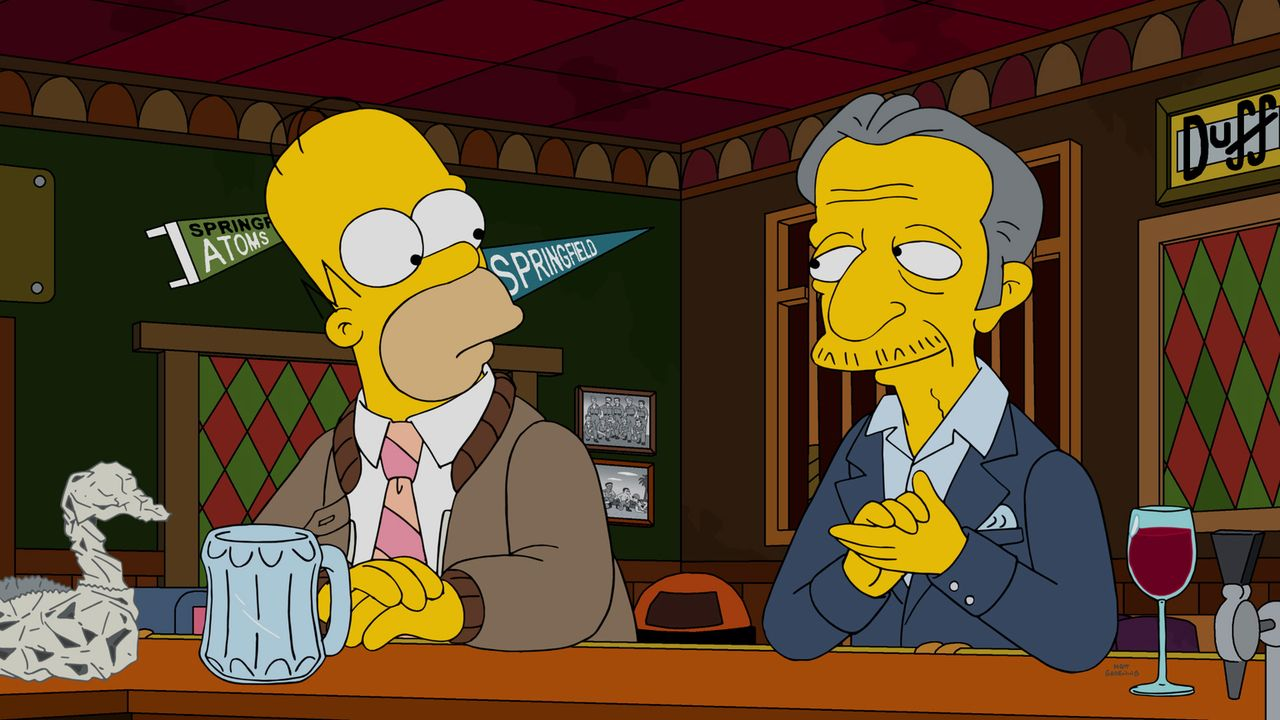 Spielt ein böses Spiel mit Homer (l.) und versucht, ihn und seine Frau auseinander zubringen: Nigel (r.) ... - Bildquelle: 2016-2017 Fox and its related entities. All rights reserved.