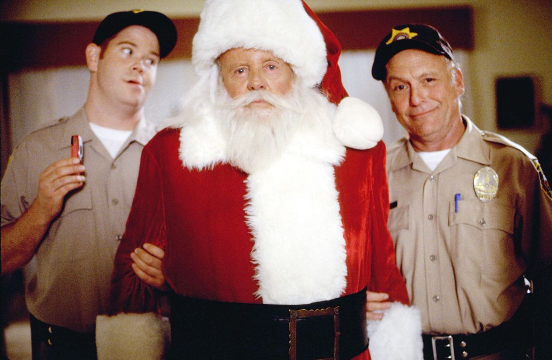 Officer Bobby Buckley (Sonny Carl Davis, r.) und Officer Calhoun (Steve Monroe, l.) nehmen am Weihnachtsabend den Nikolaus (Dick Van Patten, M.) gef... - Bildquelle: Tag Entertainment