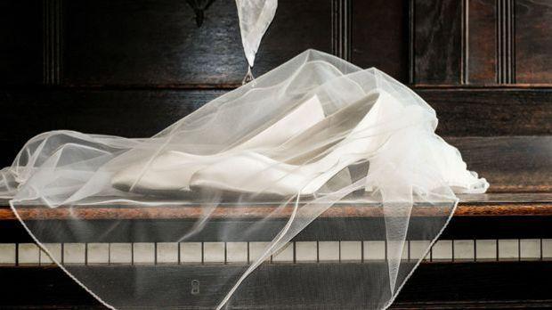 Ein Brautschleier als Kopfschmuck ist auch heute noch immer oft die erste Wahl.