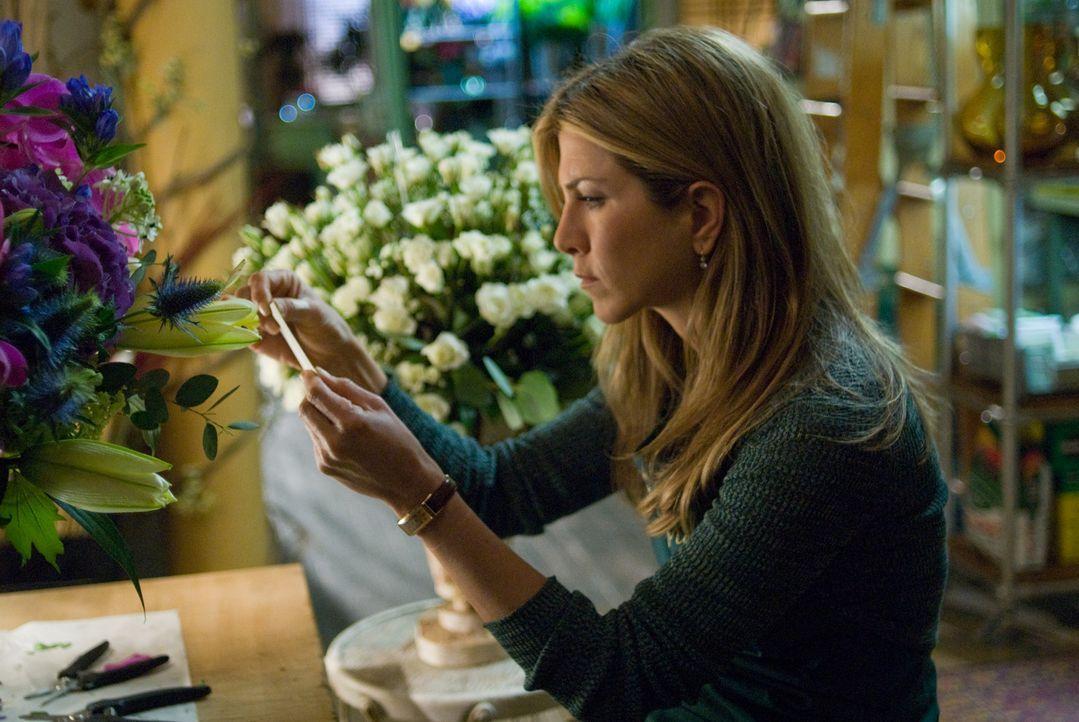 Die Blumenhändlerin Eloise (Jennifer Aniston) ist mehr als überrascht, als sie einen Strauß mit einer geheimnisvollen Nachricht erhält. Sie hat... - Bildquelle: Universal Pictures