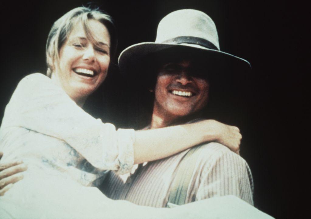 Caroline (Karen Grassle, l.) und ihr Mann Charles Ingalls (Michael Landon, r.) führen eine glückliche, harmonische Ehe. - Bildquelle: Worldvision