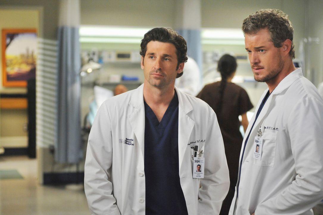Wissen noch nicht, was sie von ihrem neuen Kollegen Dr. Owen Hunt halten sollen: Marc (Eric Dane, r.) und Derek (Patrick Dempsey, l.) ... - Bildquelle: Touchstone Television