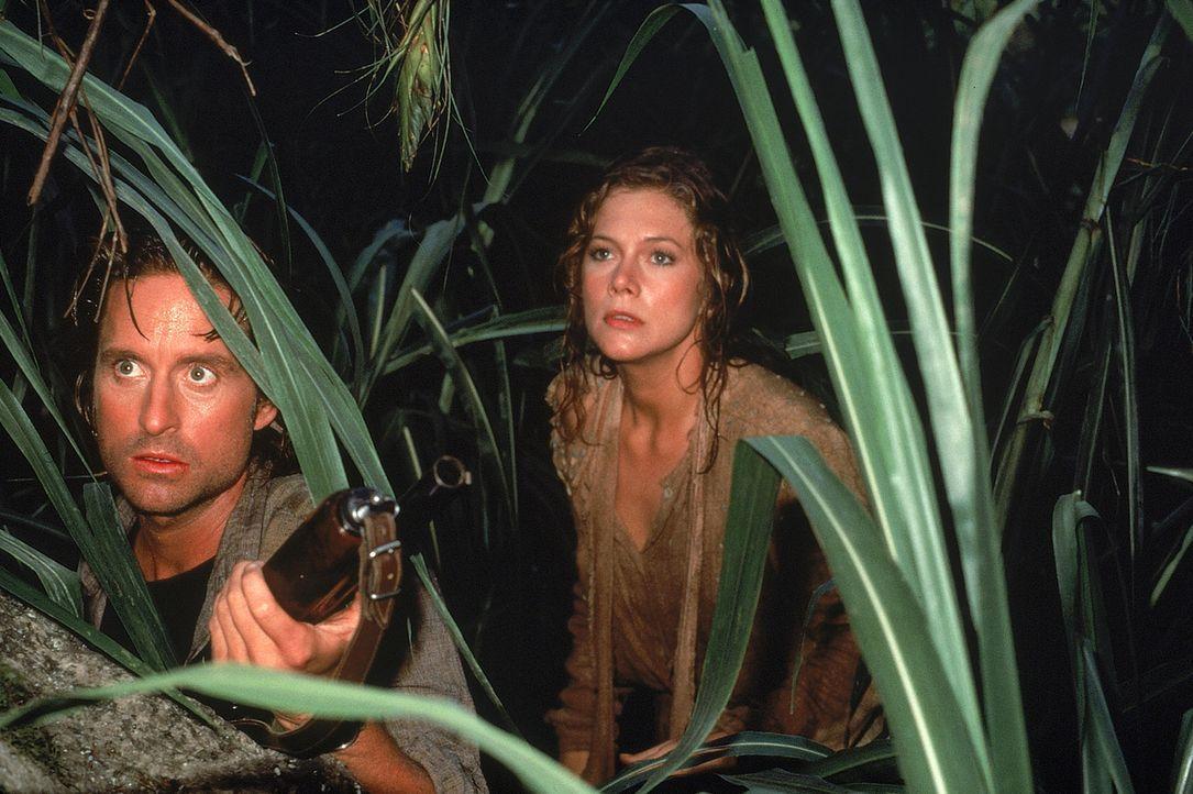 Gemeinsam machen sich Joan (Kathleen Turner, r.) und Jack (Michael Douglas, l.) auf die atemberaubende Jagd nach dem grünen Diamanten ... - Bildquelle: 1984 Twentieth Century Fox Film Corporation.  All rights reserved.