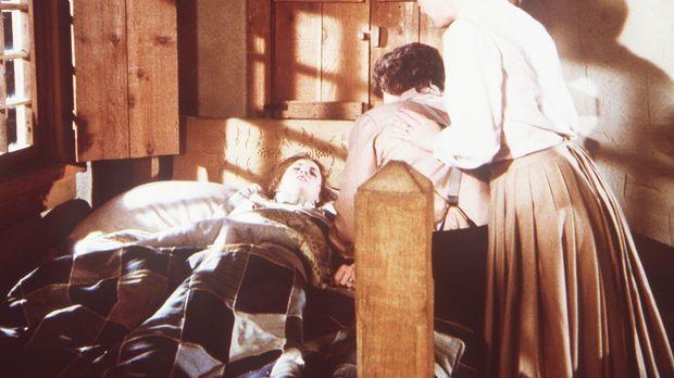Laura Ingalls (Melissa Gilbert, l.) ist während eines Tornados von einem Ast...