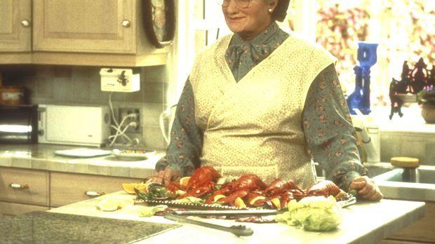 Nach kurzer Zeit ist die resolute Mrs. Doubtfire (Robin Williams, M.) völlig...