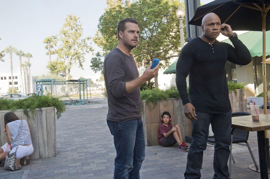 Obwohl sie einen freien Tag haben, werden Callen (Chris O'Donnell, l.) und Sam (LL Cool J, r.) gezwungen zu arbeiten, als sie einen Anruf erhalten h... - Bildquelle: Neil Jacobs 2015 CBS Broadcasting, Inc. All Rights Reserved.