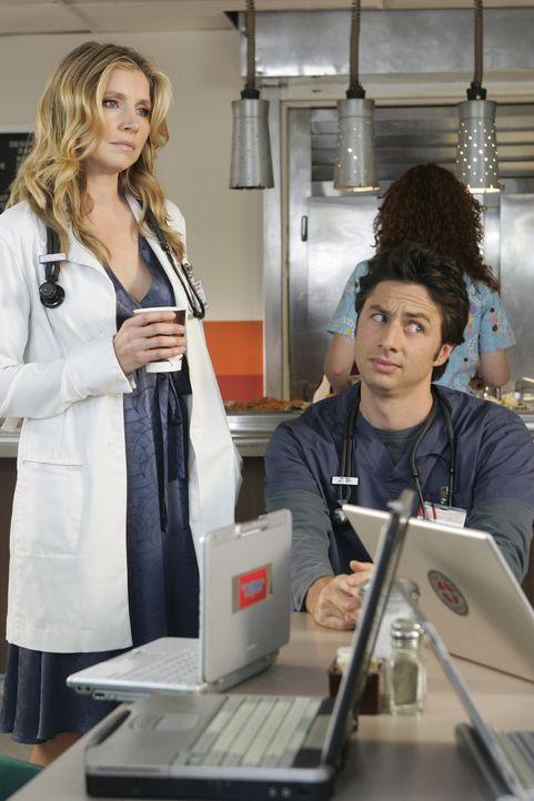 Der Wettstreit um den beliebtesten Arzt hält alle in Aufruhr: Elliott (Sarah Chalke, l.) und J.D. (Zach Braff, r.) beobachten gespannt, was sich Dr.... - Bildquelle: Touchstone Television