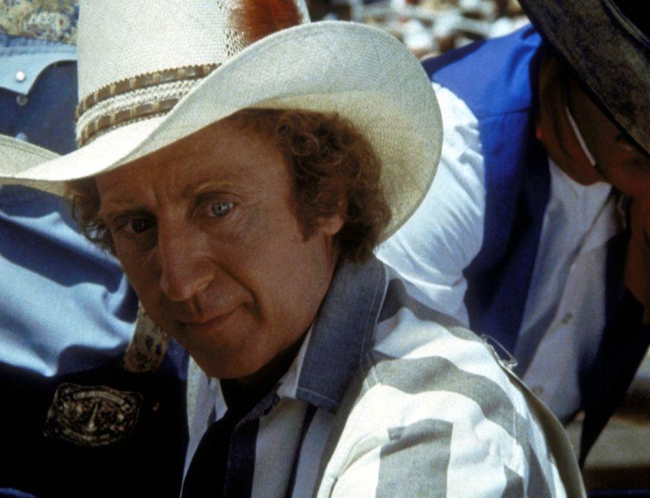 Zusammen mit seinen Kumpanen will Skip (Gene Wilder) die Rodeomeisterschaft zu einem Ausbruch aus dem Gefängnis nutzen ... - Bildquelle: Columbia Pictures Corporation
