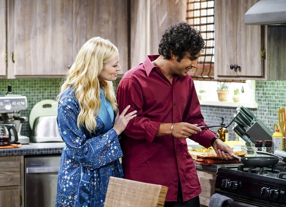 Raj (Kunal Nayyar, r.) genießt die Zeit mit seiner neuen Flamme Nell (Beth Behrs, l.), bis er erfährt, dass sie verheiratet ist ... - Bildquelle: Warner Bros. Television