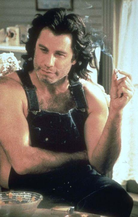 Michael (John Travolta) ist keineswegs das, was man sich unter einem Engel vorstellt. Er raucht, trinkt Bier und erfreut sich großer Beliebtheit bei... - Bildquelle: Warner Brothers