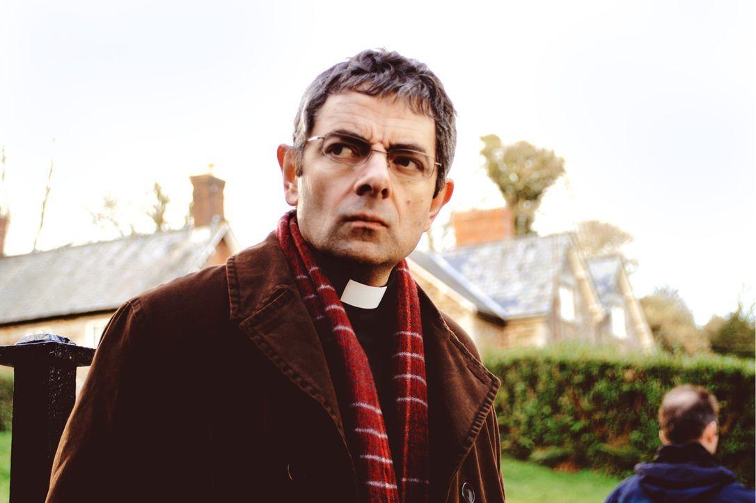 Der liebenswerte, aber etwas weltfremde Vikar Walter Goodfellow (Rowan Atkinson) lebt mit seiner Frau Gloria und den Kindern Holly und Petey in der... - Bildquelle: Constantin Film