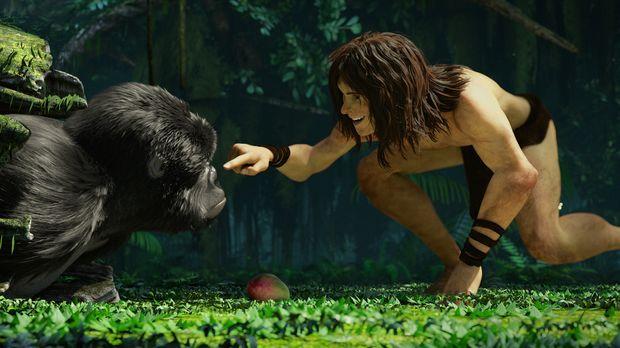 Fortbewegend, wie ein Affe scheint Tarzan vollkommen zur Familie der Affen da...