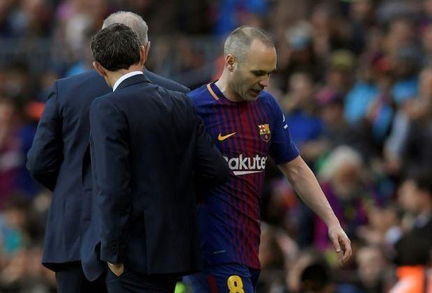 Quanjin dementiert einen Wechsel von Andres Iniesta (r.)