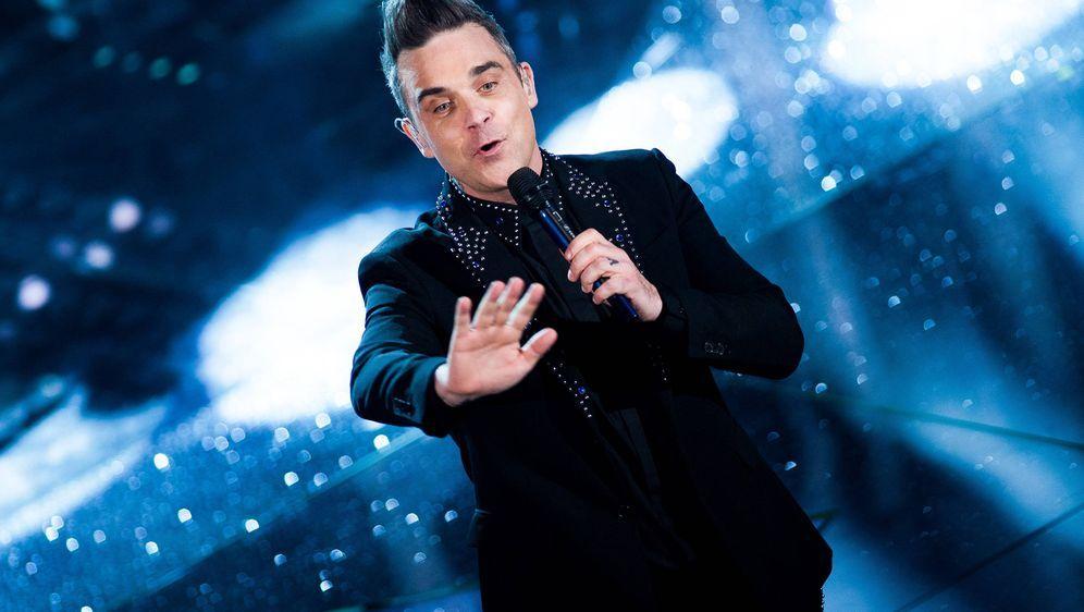 Robbie Williams wird bei der Auftaktfeier zur WM in Russland singen. - Bildquelle: imago/ZUMA Press