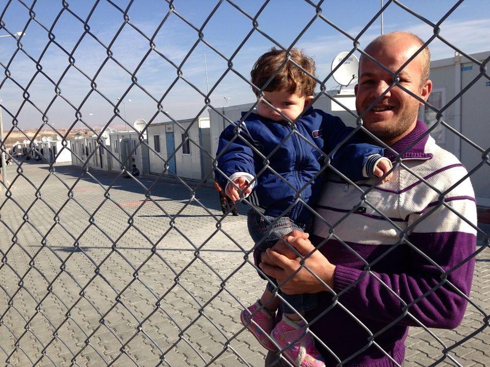 Mann mit Kind Nizip II