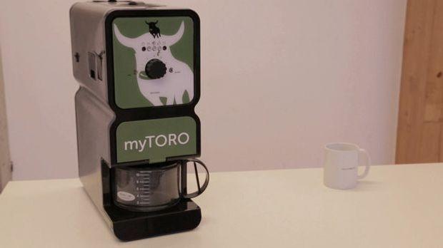 Die Kaffee-Röst-Mahl-Brüh-Maschine
