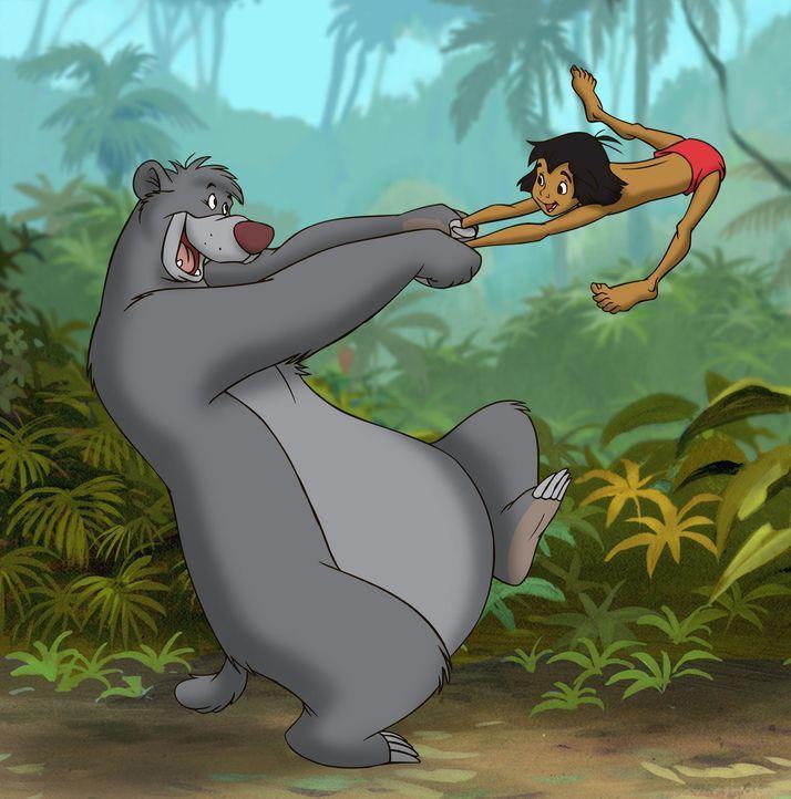Das Wiedersehen muss mit einem Tänzchen gefeiert werden: Balu (l.) und Mogli (r.) ... - Bildquelle: Disney Enterprises, Inc. All rights reserved.