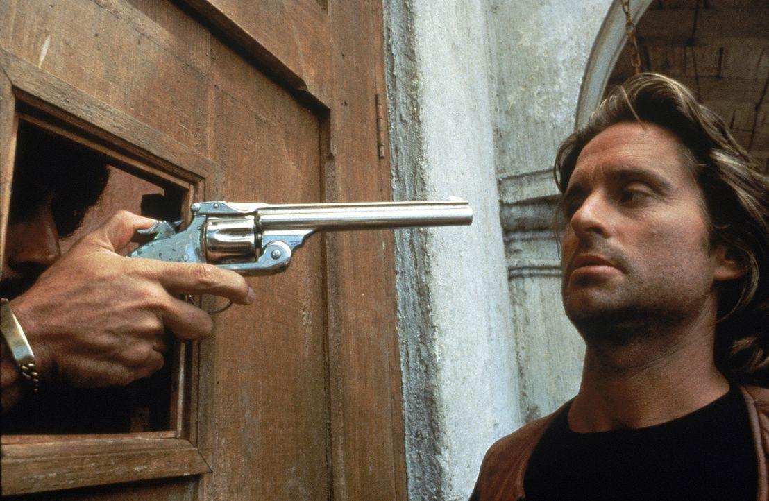 Immer wieder auf der Suche nach neuen Abenteuern gerät Jack Colton (Michael Douglas) regelmäßig in Lebensgefahr ... - Bildquelle: 1984 Twentieth Century Fox Film Corporation.  All rights reserved.