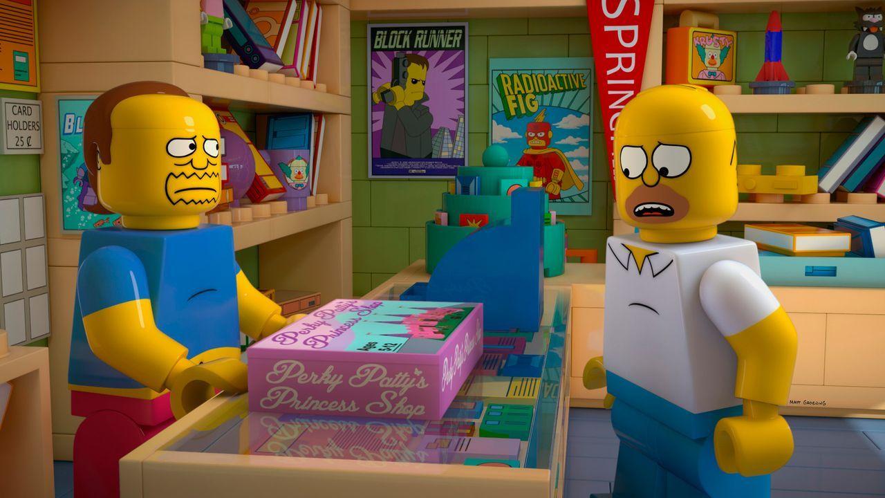 Als Lego-Homer (r.) im Laden des Comicverkäufers (l.) ein Spiel für seine Tochter Lisa kauft, quälen ihn seltsame Visionen: Immer wieder hat er das... - Bildquelle: 2013 Twentieth Century Fox Film Corporation. All rights reserved.