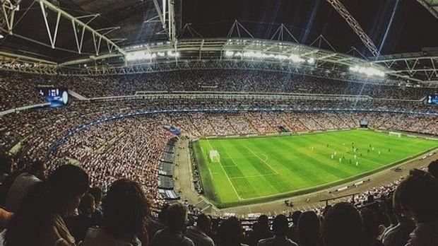 Fußballstars auf Feld
