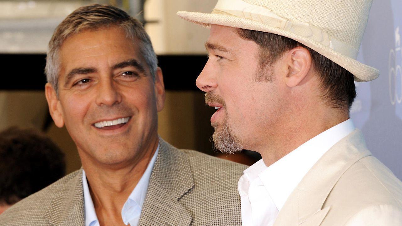 George Clooney und Brad Pitt  - Bildquelle: AFP