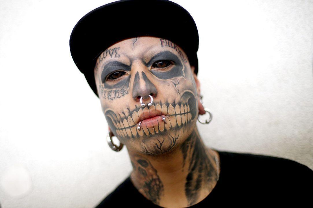 Gesichts-Tattoo-dpa - Bildquelle: dpa