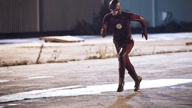 Ein Metahuman, der sich in flüssiges Asphalt verwandeln kann, hält Barry alia...