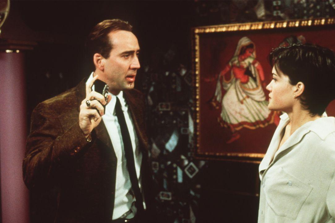 Was hat Julia Costello (Carla Gugino, r.) mit dem Mord an dem Verteidigungsminister zu tun? Der Cop Rick Santoro (Nicolas Cage, l.) geht der Sache a... - Bildquelle: Touchstone Pictures