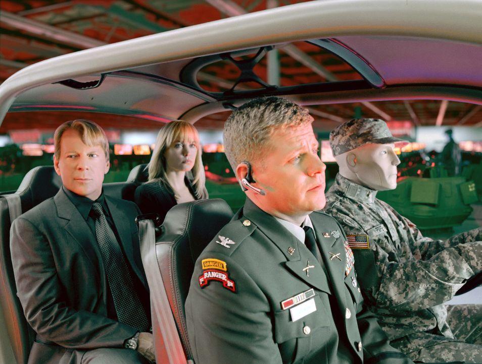 Nichts ist mehr echt: Gemeinsam versuchen die Surrogates von FBI-Agent Greer (Bruce Willis, hinten l.) und Agentin Peters (Radha Mitchell, hinten r.... - Bildquelle: Stephen Vaughan Touchstone Pictures.  All Rights Reserved