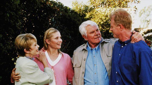 John Camden (Peter Graves, 2.v.r.) und seine Frau Ruth (Barbara Rush, l.) hab...