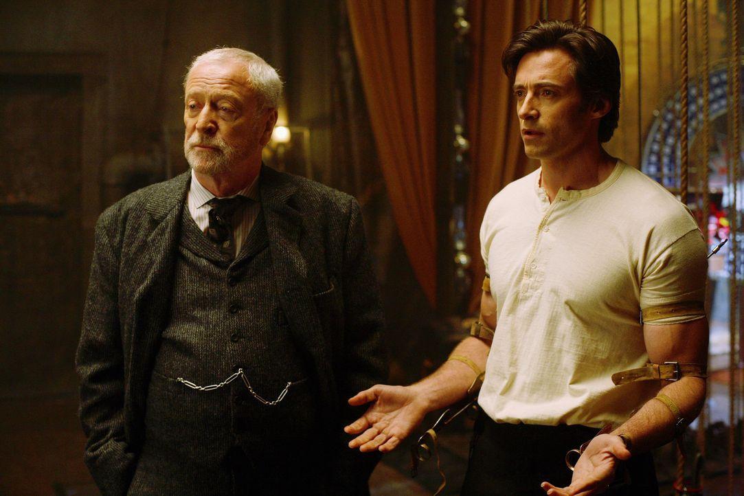 Glauben, Alfred Borden ist am Tod von Julia Schuld, da er einen anderen Knoten als vereinbart um ihr Handgeleckt gemacht hat: Robert Angier (Hugh Ja... - Bildquelle: Warner Television