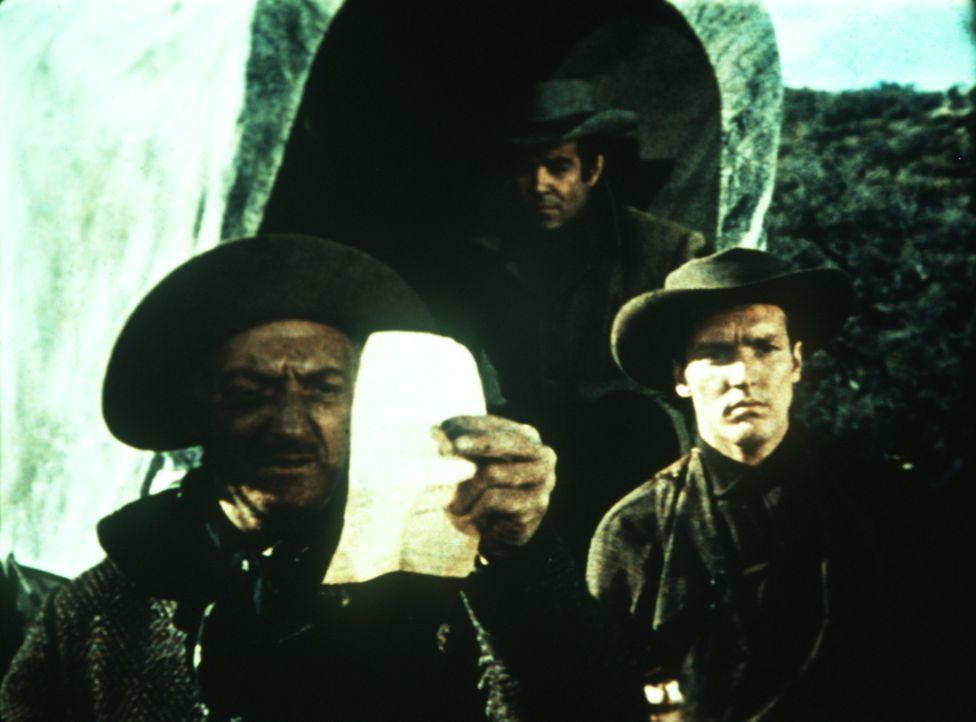 Stolz betrachtet Jeb Drummond (Everett Sloane, l.) den Vertrag, den er Ben Cartwright abgepresst hat. - Bildquelle: Paramount Pictures