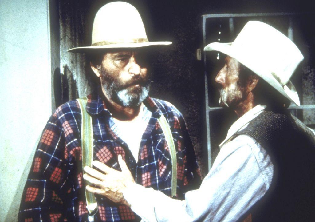 Bart Younger (Robert Donner, r.) befreit Isaiah Edwards (Victor French, l.) aus dem Gefängnis, um ihm sein Geld abzunehmen. - Bildquelle: Worldvision