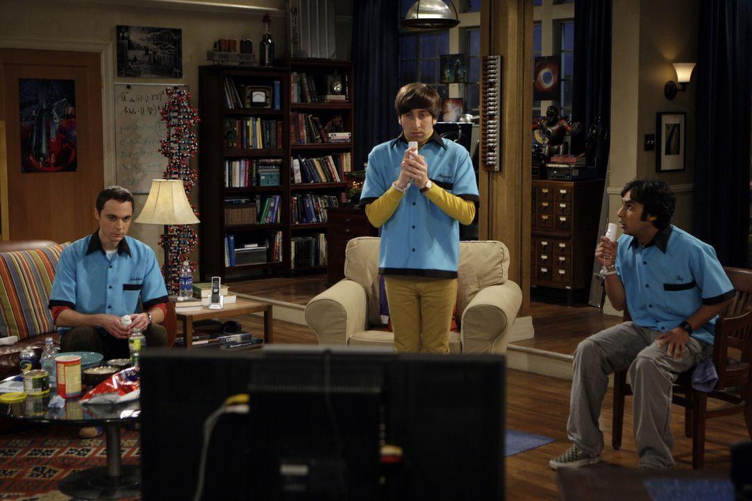 Freuen sich auf Weihnachten: Sheldon (Jim Parsons, l.), Rajesh (Kunal Nayyar, r.) und Howard (Simon Helberg, M.) ... - Bildquelle: Warner Bros. Television
