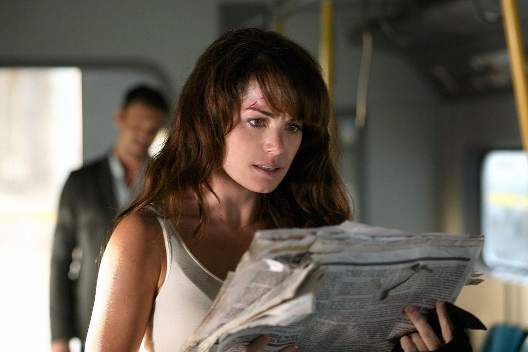 Was war die Ursache für den Unfall der Einschienenbahn? Lois (Erica Durance) versucht sich als Detektivin ... - Bildquelle: Warner Bros.