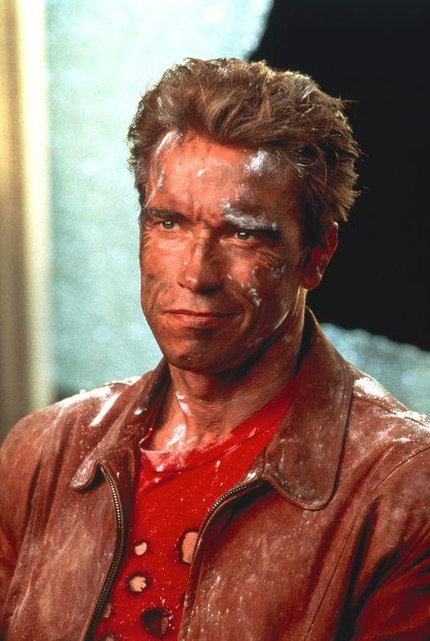 Jack Slater (Arnold Schwarzenegger) ist ein Leinwand Held. In seinen Filmen macht er den Verbrechern das Leben zur Hölle. Doch durch eine magische... - Bildquelle: 1993 Columbia Pictures Industries, Inc. All Rights Reserved.