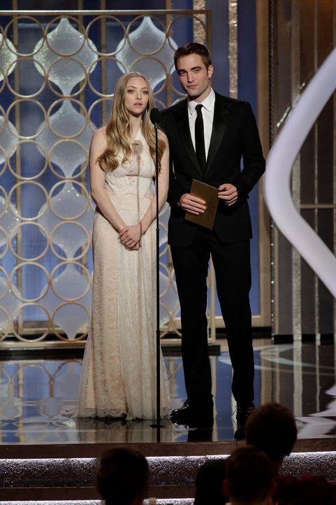 Amanda Seyfried und Robert Pattinson - Bildquelle: +++(c) dpa - Bildfunk+++ Verwendung nur in Deutschland