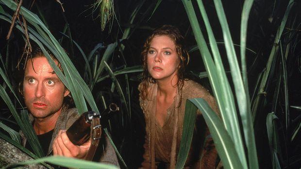 Gemeinsam machen sich Joan (Kathleen Turner, r.) und Jack (Michael Douglas, l...