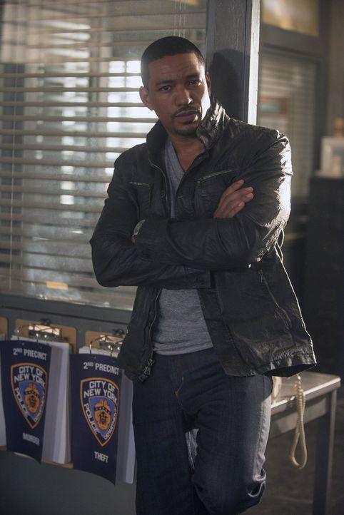 Geht gemeinsam mit Laura auf Verbrecherjagd: Billy Soto (Laz Alonso) ... - Bildquelle: Warner Bros. Entertainment, Inc.