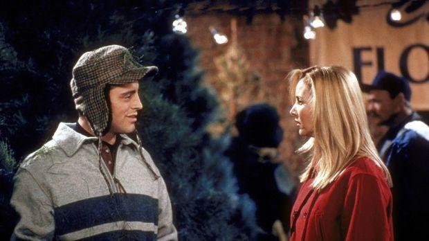 Phoebe (Lisa Kudrow, r.) fragt sich, warum Joey (Matt LeBlanc, l.) mit Tannen...