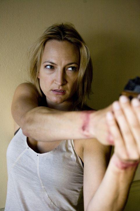 Um ihr Gewissen zu beruhigen, begibt sich die Profikillerin Eve (Zoe Bell)  auf einen Rachefeldzug gegen ihre früheren Auftraggeber ... - Bildquelle: 2009 Colton Productions, Inc. All Rights Reserved.