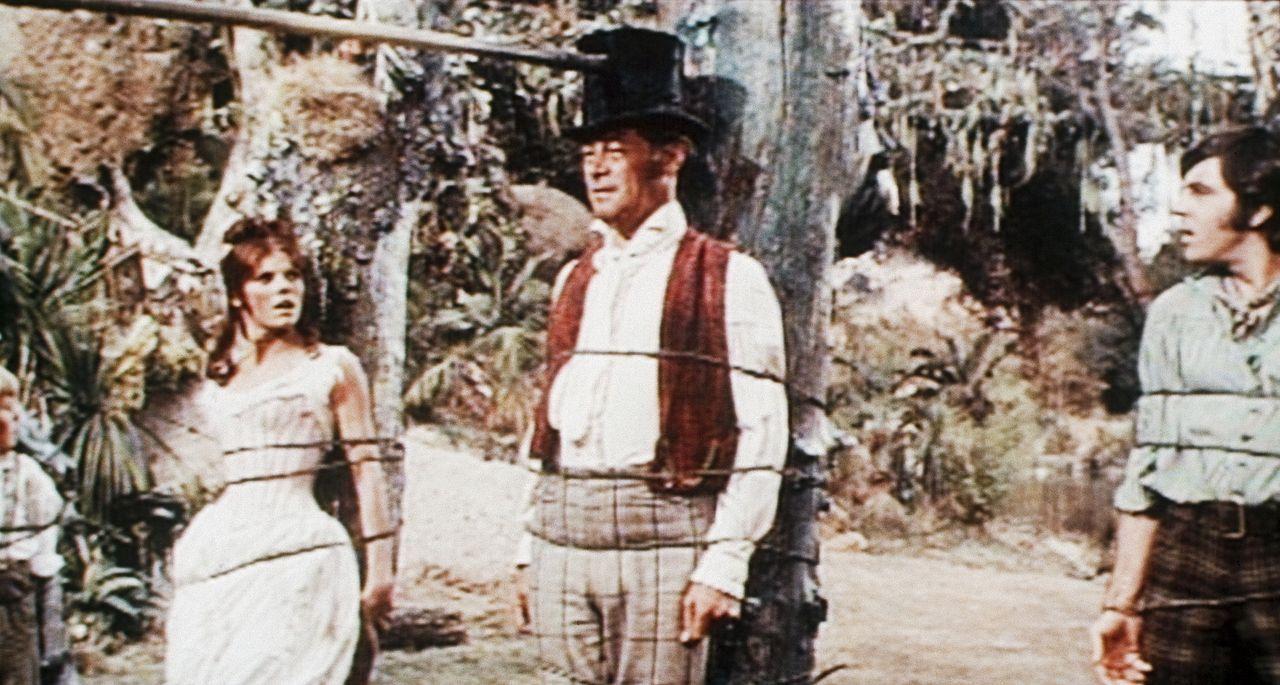 Auf ihrer Abenteuerreise werden Emma (Samantha Eggar, l.), Dolittle (Rex Harrison, M.) und Matthew (Anthony Newley, r.) von Eingeborenen gefangengenommen ...