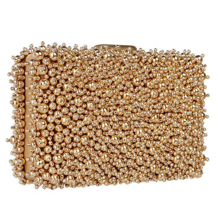 Die perfekte Tasche in gold mit Kugeln - Bildquelle: dresscoded.com