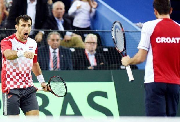 Marin Cilic (l.) und Ivan Dodig bejubeln ihren Sieg