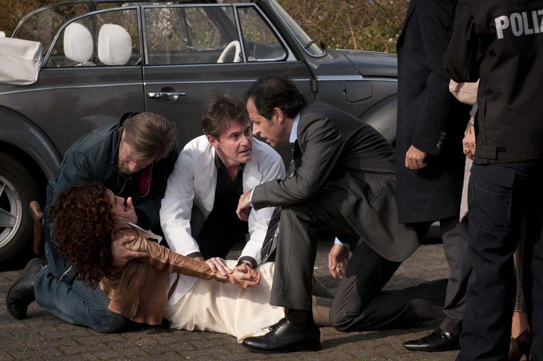 Können sie Tanjas Leben retten? (v.l.n.r.) Mick (Henning Baum), Meisner (Robert Lohr) und Ferchert (Helmfried von Lüttichau) ... - Bildquelle: SAT.1