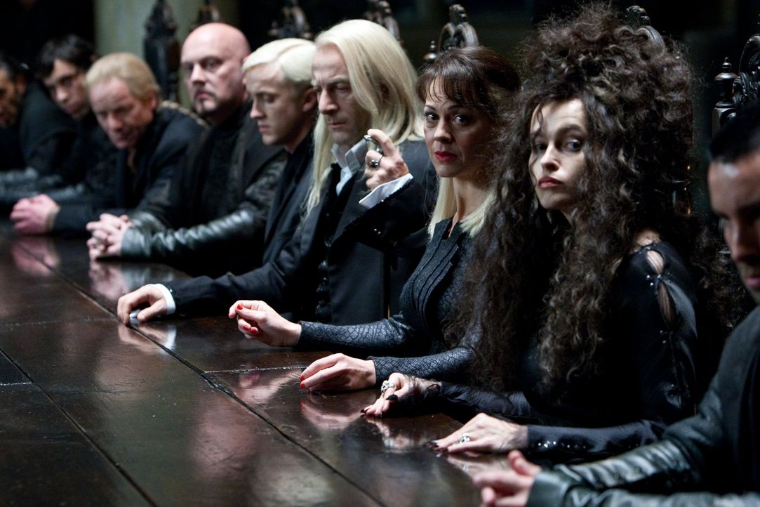 Voldemort centre with Bellatrix Lestrange left Lucius Malfoy right and several masked Death Eaters back in Harry Potter and the Order of the Phoenix