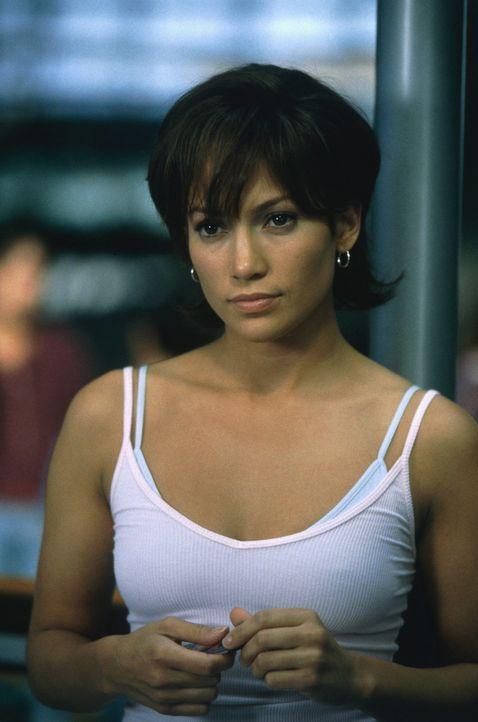 Eigentlich hatte die attraktive Ex-Kellnerin Slim (Jennifer Lopez) ihrem reichen Ehemann Mitch in der Kirche versprochen, bei ihm zu bleiben, bis da... - Bildquelle: 2003 Sony Pictures Television International