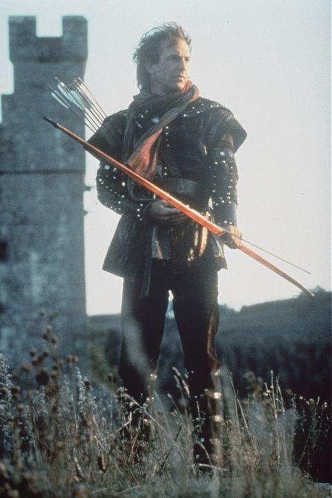 Als Robin von Locksley (Kevin Costner) sieht, wie der Sheriff von Nottingham das Volk auspresst und unterdrückt, nimmt er den Kampf gegen den erbar... - Bildquelle: WARNER BROS.