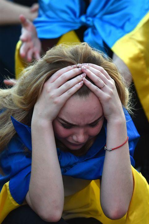 Ukraine_crying_000_BZ6DI_Sergei SUPINSKY_AFP - Bildquelle: AFP / Sergei SUPINSKY