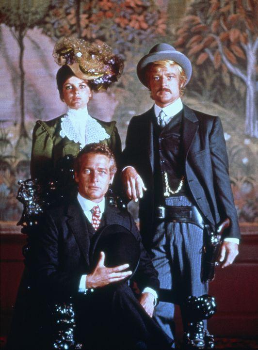 Die Desperados Butch Cassidy (Paul Newman, vorne) und Sundance Kid (Robert Redford, r.) kommen zu zweifelhaften Ruhm, als sie denselben Zug gleich z... - Bildquelle: Twentieth Century-Fox